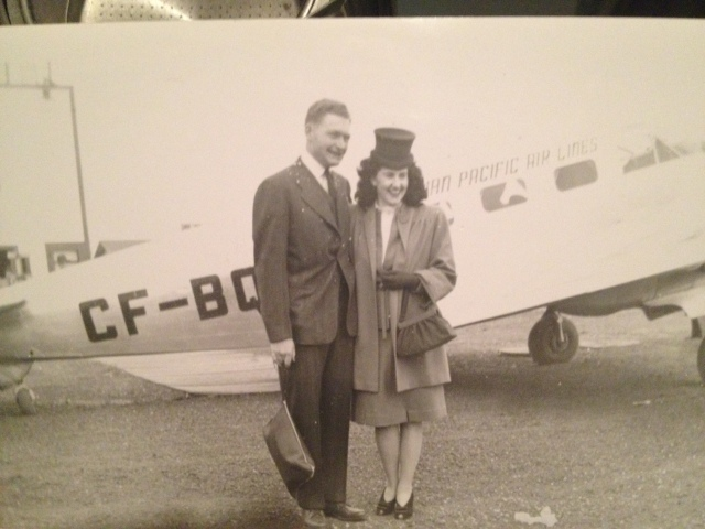 1940s Vintage image of couple in front of Canadian Pacific airplane